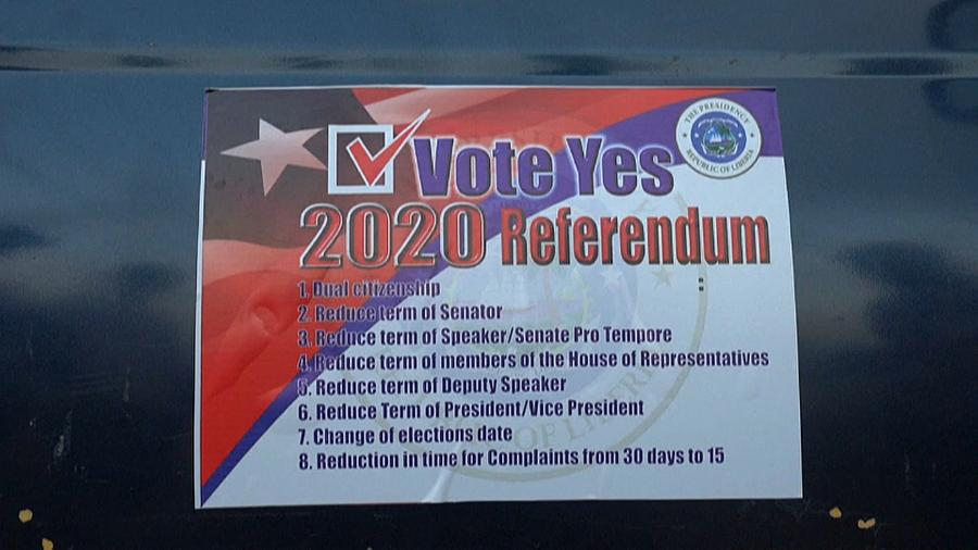Card outlining the eight referendum proposals (photo credit: africanews/AFP)