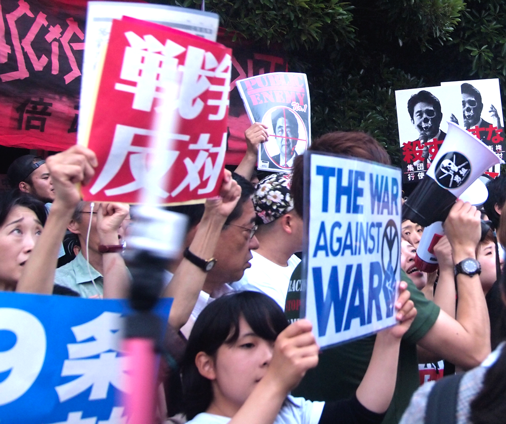 Protesters oppose Against Abe's Move to Reinterpret Japan's Pacifist Constitution in 2014 (photo credit: Natsuki Kimura-Flickr)