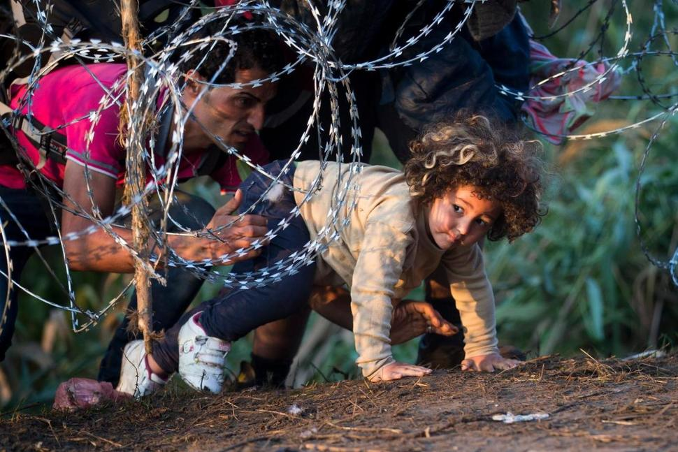 Child crossing from Serbia to Hungary (photo credit: AP Photo/Darko Bandic)