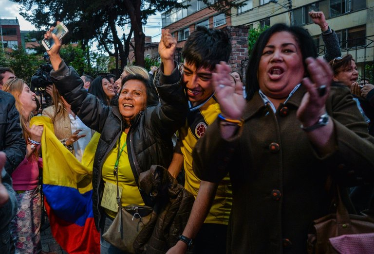 Opponents of the Colombian peace agreement celebrating on Sunday in Bogotá, the capital, after the results of a national referendum were announced (photo credit: Credit Diana Sanchez/Agence France-Presse — Getty Images)