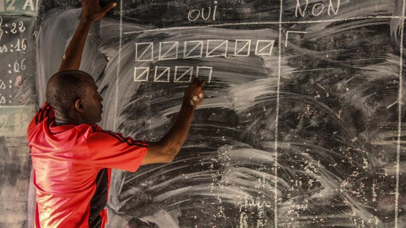An election officer tallies the results (photo credit: Ibrahim Youssouf/AFP)