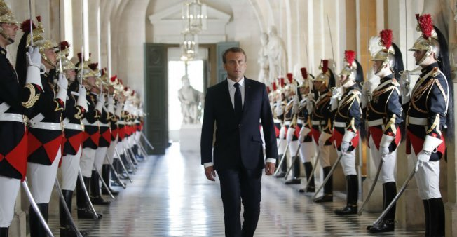 Emmanuel Macron walks towards the Hemicycle to address Parliament in a Congress at Versailles on July 9 (photo credit: Charles Platiau/AFP)