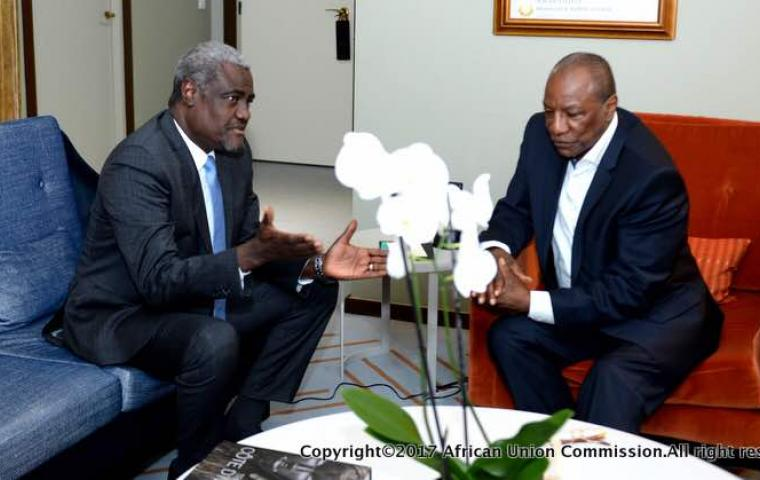 Guinea President Alpha Conde with AU Commission Chairperson Moussa Faki Mahamat (photo credit: AU Commission)