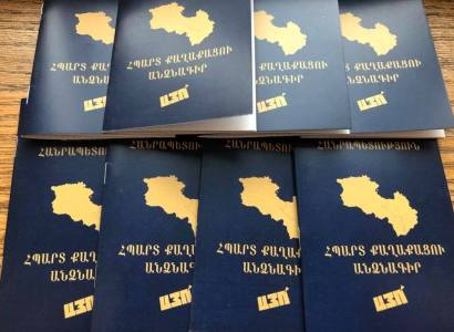 Prime Minister of Armenia unveils booklet which reads 'Passport of  a Proud Citizen - YES' (photo credit: Office of the Prime Minister)
