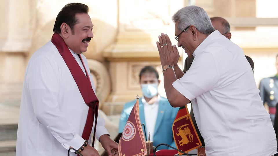 President Gotbaya Rajapaksa - right - swears in his brother and former President Mahinda Rajapaksa as Prime Minister (photo credit: Reuters)