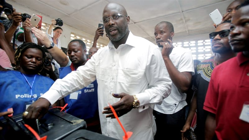 President Weah casts his vote ruing the runoff presidential election (photo credit: Thierry Gougnon/Reuters)