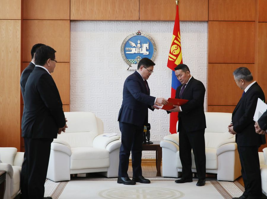 President of Mongolia - second from right - receives proposed constitutional amendments from speaker - second from left (photo credit: Montsame)
