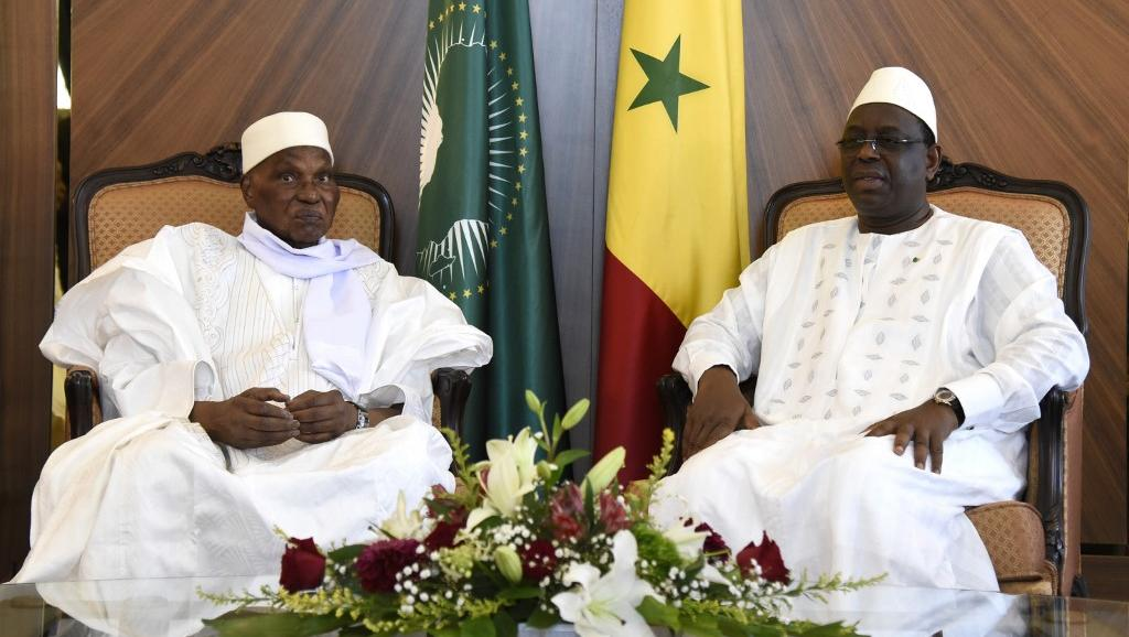 Former President Abdoulaye  Wade (left) and President Macky Sall meeting in Oct 2019 (photo credit: Seyllou/AFP)