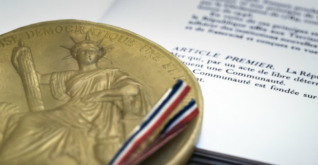 Seal and article 1 of the 1958 French Constitution (photo credit: Joel Saget/AFP)