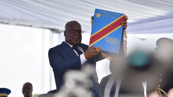 Tshisekedi holds constitution during his inauguration (photo credit: Olivia Acland/Reuters)