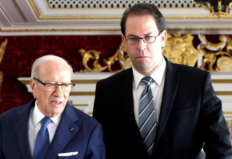 Tunisian Prime Minister Youssef Chahed (R) and Tunisian President Beji Caid Essebsi (photo credit: AFP)