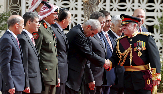 Jordan's King Abdullah shakes hands as he arrives for the opening of the third ordinary session of the 17th parliament  (photo credit: REUTERS/Muhammad Hamed)
