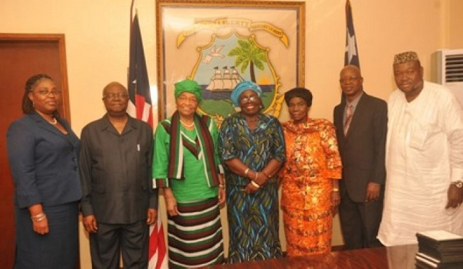 Liberian President Sirleaf with members of the Constitutional Review Committee [photo credit: Buzz Liberia]