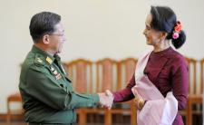 Daw Aung San Suu Kyi met with Senior Gen. Min Aung Hlaing after a meeting in 2015 (photo credit: Hyo Hein Kyaw/Agence France-Presse — Getty Image)