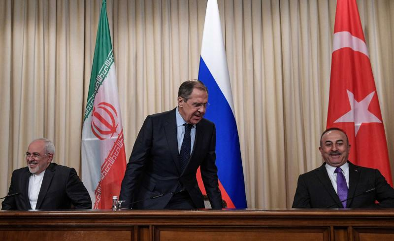 Russian Foreign Minister Sergei Lavrov (C), Turkish Foreign Minister Mevlut Cavusoglu (R) and Iranian Foreign Minister Mohammad Javad Zarif (photo credit: The Arab Weekly)