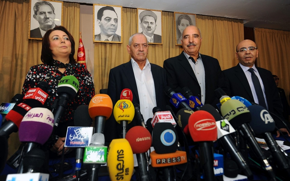 A photo taken on September 21, 2013 shows Tunisian mediators (LtoR) the President of the Tunisian employers union (UTICA), Wided Bouchamaoui, Secretary General of the Tunisian General Labour Union (UGTT) Houcine Abbassi (L) , President of the Tunisian Human Rights League (LTDH), Abdessattar ben Moussa and the president of the National Bar Association, Mohamed Fadhel Mahmoud at a press conference in Tunis. (photo credit: Fethi Belaid / AFP / Getty Images)