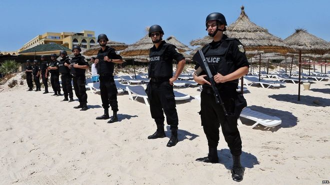 Armed members of Tunisia's security forces were deployed to the beach at Sousse for a ceremony of remembrance one week after the attack (photo credit: BBC)