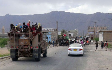 Pro-government forces backed by the Sunni Arab coalition near Loder in south Yemen last week (photo credit: FT)